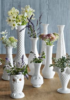 A grouping of milk glass vases is so sweet. Ooh, I have to add a few of these to my collection!