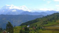 View of traditional village with back view of Himalayan range