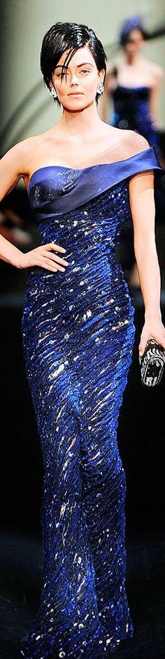 Armani Privé. Dress is gorgeous but that looks like Devo plastic hair!