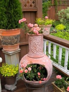 Chiminea as a planter.  cute!  Plus I like the colors in this yard.