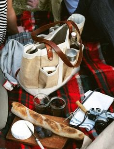 Cheese, bread and a camera -- what else do you need for the perfect picnic? #picnic #cheese #plaid