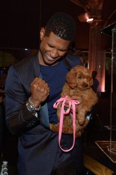 "Usher loves his GoldenDoodle : a mix of GoldenRetriever and Poodle ""Usher bids 12K on a puppy.."""