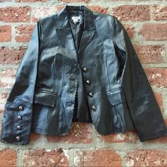 Black leather jacket 100%leather with polyester lining. Beautiful scalloped detail on the collar al the way down the front. Detail on two front pockets.  Silver buttons. Worn three times. A few spots on front J'Envie Jackets & Coats