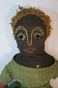 Antique embroidered face early black doll