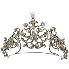French Princely Family Collection Antique Diamond Tiara. This spectacular Louis XIV-style convertible tiara was apparently acquired by a French aristocratic family in 1884 as a bridal gift to a princess. The jeweler who supplied this elegant jewel was Maison Robert Degeresme.
