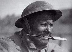 Member of British 3 Commando Brigade in training at Achnacarry, Scotland, United Kingdom, circa 1942-1945; note second pattern F-S dagger between teeth.