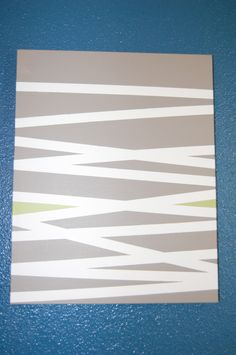 How to paint stripes on a canvas using painters tape.
