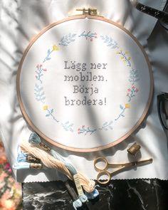 """This is your sign to start a new hobby - """"Put down the phone. Start embroidering!"""". 🧵 Embroider your favorite photo, or a pattern designed by you in our Design Editor. Check out our website for fun crafting. 🌞 Link in bio. Det här är ett tecken på att du ska testa på en ny hobby! 🧵 Brodera ditt favoritfoto eller ett mönster som du själv designat i vårt Designverktyg. Kolla in vår hemsida för roligt pyssel. 🌞 Länk i bion."""