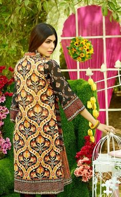 Shirt: Fabric: Embroidered Swiss Voil Front, Printed Back with Sleeves. Shalwar/Trousers: Fabric: Printed Trouser.