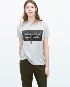 T-SHIRT WITH LEATHER PATCH