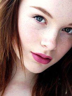 Pretty Girl. Fair skin, Deep eyes, Beautiful full lips of a wonderful color, freckles, and gorgeous hair. A perfect Ten.