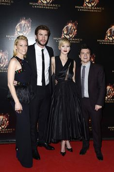 Lawrence gained international fame for playing heroine Katniss Everdeen in the Hunger Games film series (2012–15)