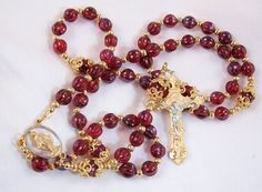 Red siam color beads with gold pewter crucifix rosary, $40