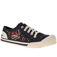 Women's Navy Rocket Dog Rdog Jazzin Jynxed Tattoo at Schuh. It's like getting a tattoo but without the pain! The Jazzin Jynxed Tattoo is a Rocket Dog plimsoll made with a navy canvas upper and embroidered tattoo designs on the vamp. A flexible rubber sole and cushioned insole provide a comfy finish.