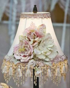 A pretty lampshade but yet not too froo-froo... can still be used in a den of eclectic furnishings.