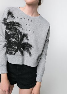 sweat-shirt cropped palmiers 25 €