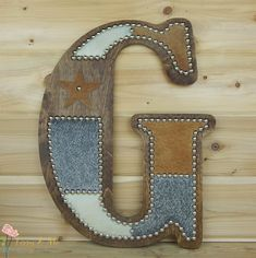 Cowhide Wall Letter G handcrafted by Lizzy & Me. Made to order. Do you need a different letter? You can see our other custom cowhide letters here: https://www.etsy.com/shop/LizzyandMe?section_id=15627387&ref=shopsection_leftnav_3 Or convo us for a custom order. • Made from a wooden
