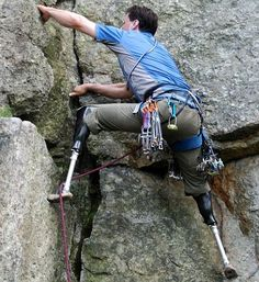 Hugh Herr rock climbs with two prosthetic legs.
