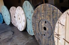 Large Wall Clocks created using Recycled Wooden Spools Each one is unique in itself, leaving no two alike. Sizes (Diameter): 32 inches to 48 inches Prices: $275 & Up Limited availability Each clock comes fully operational with a motor and includes your hour, min, and second hands. Repin and share it! I worked really hard on these!