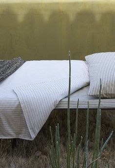 TOAST PRE COLLECTION | Traditional woven ticking stripe bedlinen in soft, weighty, organic cotton. Two rows of satin stitch along the edge of the pillowcase.