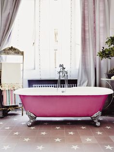 fuschia bath tub and lavender silk drapes. love it, how glamorous!