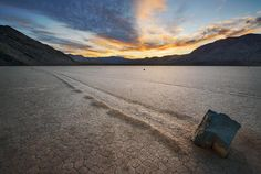 The Racetrack - Death Valley - Sunset on the Racetrack Playa in Death Valley National Park. The dried mud has a slightly shiny surface which actually reflected some of the warm light from the sky. A very unique and special place - but sadly, in danger of overuse.