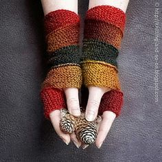 These mitts basically consist of a 10-stitch wide strip that winds around the wrists and hands. he strip is connected as you work, so no sewing is required. They are all in garter stitch and a nice way to show of variegated yarn.
