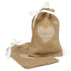 "Perfect for your Western Wedding. Burlap favor bags with twine drawstring closure and white ribbon and one of five designs in white. Package of 25. Size 6.25"" x 4.25"". (size may vary slightly)"