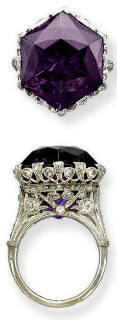A BELLE EPOQUE AMETHYST AND DIAMOND RING Set with an hexagonal amethyst to the openwork millegrain diamond-set gallery and half-hoop, circa 1915, ring size 7, with French assay marks for platinum and gold Christie's.