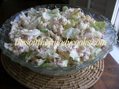 Cauliflower Salad  --  raw cauliflower, lettuce, onion, Parmesan, bacon bits, and mayo.  Can add some chopped broccoli to it as well.