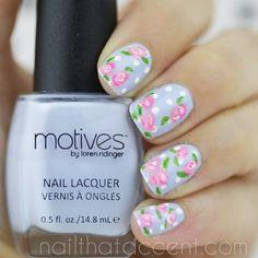 Violet nails with polka dots and roses