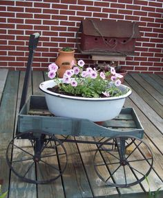 Old wash pail filled with pretty petunia's ~ @ home