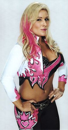 WWE Diva Natalya , She is an awesome wrestler , and it doesn't hurt that she's a HART too , lol I heart Natayla oxoxoxoxoxoxoxo