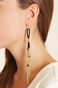 A pair of faux suede duster earrings with fish hook backs, a high-polish beaded design, and hanging chain fringe.