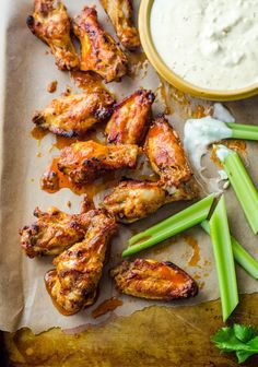 The last thing I want to do if there's a party happening and a major game on the television is man the deep-fryer back in the kitchen. But you can't have a Game Day party without buffalo chicken wings on the buffet table — inconceivable. The solution, obviously, is to turn to the next best thing: the oven. Doused in a double dose of hot sauce — first to marinate and then to coat — these oven-baked wings are arguably just as crispy, just as sticky, and just as addictive as their deep-fried…
