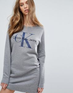 Buy it now. Calvin Klein Jeans Logo Sweatshirt Dress - Grey. Dress by Calvin Klein, Soft-touch sweat, Round neck, Logo print, Fitted trims, Relaxed fit, Machine wash, 100% Cotton, Our model wears a UK S/EU S/US XS and is 175cm/5'9 tall. ABOUT CALVIN KLEIN The epitome of minimalist chic, Calvin Klein transfers his love of clean lines seamlessly across the label�s accessory and lingerie collection. Chicly functional purses and bags sit alongside seamless cotton bras, sporty swimwear and luxe…