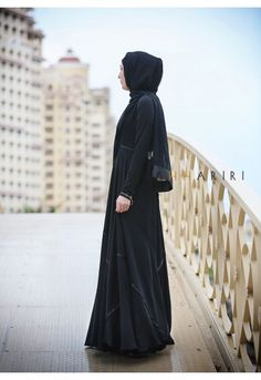 Black Abaya- hair is covered and face is veiled. There is a big stigma of women wearing veils. It was customary to wear an enveloping outer garment even before Islam for protection while traveling