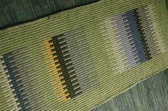 Handwoven green wool rug