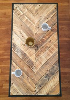 Reclaimed pallet board chevron pattern coffee table with metal hairpin legs. What we love: The natural finish of the pallet boards when they are sanded down. It's charming, rustic, and sophisticated, all in one!