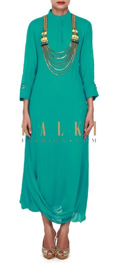 Buy this Peacock green kurti adorn in fancy neckline only on Kalki