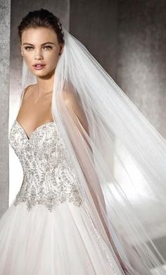 Pronovias Shika by Saint Patrick wedding dress currently for sale at 40% off retail.