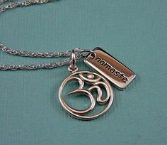 I want this namaste/om necklace ... if only the designer didn't use comic sans :/
