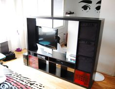 "Materials: Expedit tv storing unit, 2 rotating casters from hardware store, 1 shelf 30cm wide 19mm thick 2m long. screws, drill, saw Description: Since I've got an apartment with living room and a small bedroom (without doors), I wanted a furniture to place in front of the opening to my ""bedroom area"" to create a [&hellip"