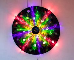 artejuliobekhor | VINIL-NEONES Spark, 2014 Installation of neon lights over vinyl records and vinyl record on moving installation motor 62.99 x 62.99 x 5.91inches 160 x 160 x 15