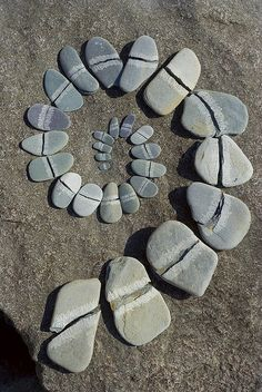 A homage to Andy Goldsworthy. I made this spiral by splitting slate pebbles (I bashed them with a rock) and laying them out on a slab on the shore of Loch Lomond in Scotland. Mandala, Land Art, Art Pierre, Andy Goldsworthy, Deco Nature, Love Rocks, Sticks And Stones, Environmental Art, Natural Forms