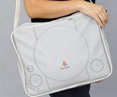 Tote your gear around in style with this original Playstation bag. Inspired by the iconic gaming console, the bag replicates all the lines and contours of the original device perfectly and features heavily padded sides that make it great for transporting laptops.