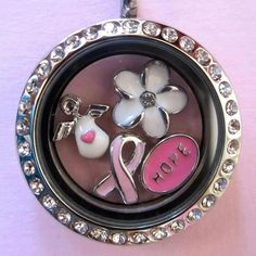 To design your own locket go to www.SusanSellsOO.origamiowl.com