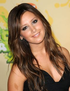 Ashley Tisdale's pretty medium brown hair with golden highlights
