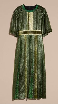 A long and lightweight Burberry dress in light-catching lamé. The loose-fit top is cut with soft shoulders and a defined waist, while the skirt is made up of a patchwork of print panels.