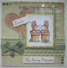 """""""The Penny Black stamp I have used is actually a row of bunnies playing around in pots which is fabulous for Easter or spring cards .. but I thought the 2 on the end were looking at each other in such an adoring (and adorable!) way that I masked the stamp and just used these two cute creatures. This is my Valentine card for my husband so I deliberately swerved girly colours and/or flowers. He also hates red, so I decided to go with more natural garden colours to compliment the bunnies."""""""
